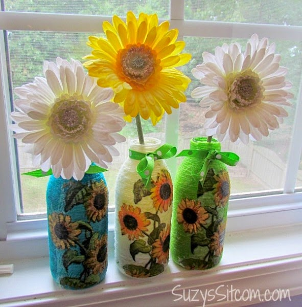 http://suzyssitcom.com/2014/05/great-recycled-craft-yarn-wrapped-bottles-with-decoupage.html