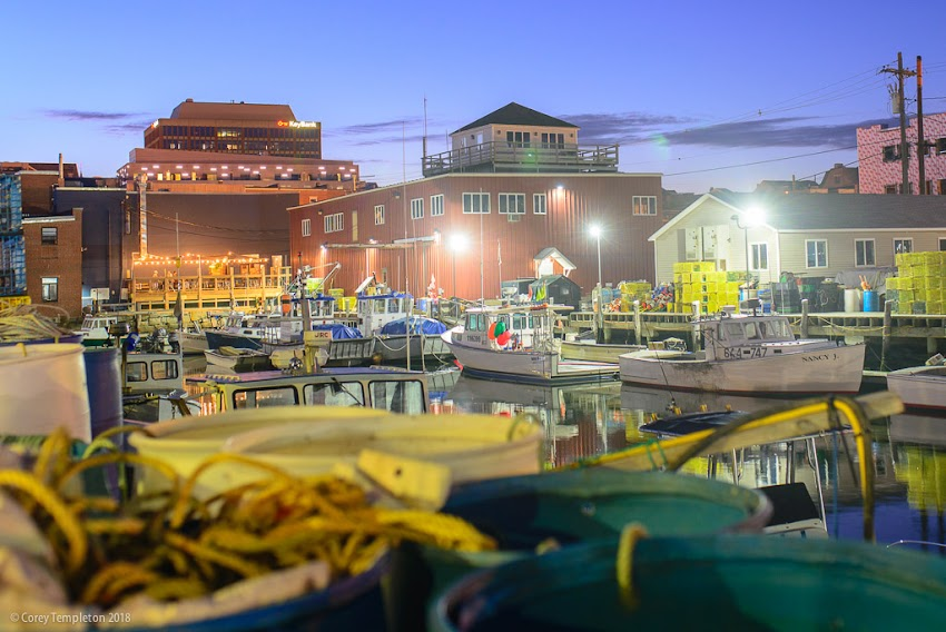 Portland, Maine USA June 2018 photo by Corey Templeton. A view of Merrill's Wharf at night, a wharf with an apparently successful mix of industry, office and restaurant space