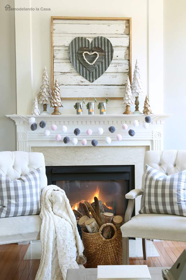 family room fireplace with rustic mantel display to celebrate Valentines day