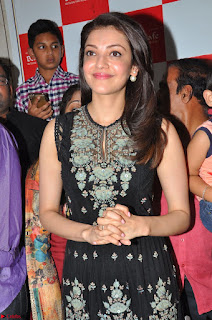 Kajal Aggarwal in lovely Black Sleeveless Anarlaki Dress in Hyderabad at Launch of Bahar Cafe at Madinaguda 008.JPG