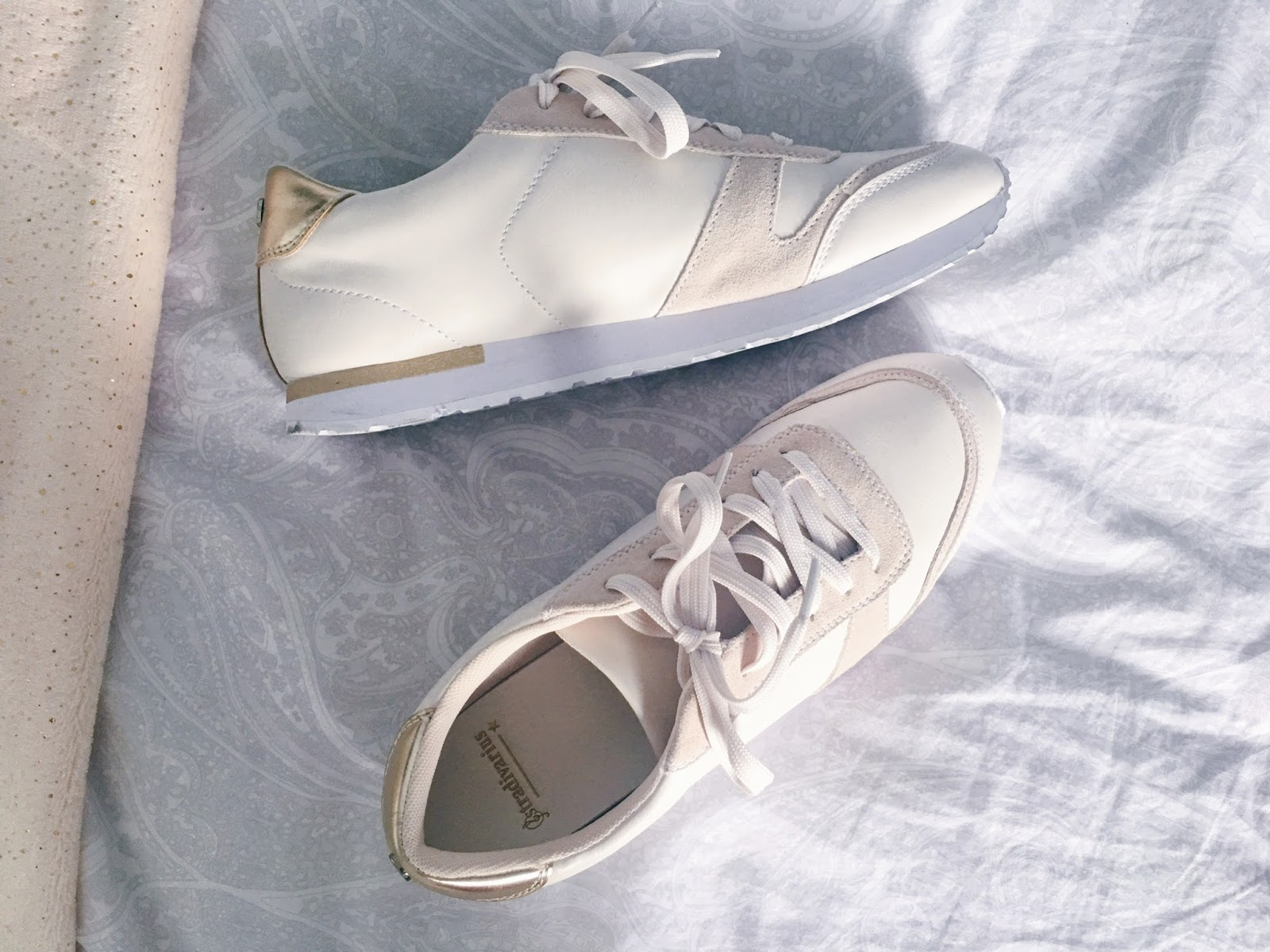 white and gold trainers