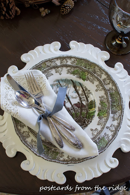 Vintage silverware and linens paired with brown transferware.