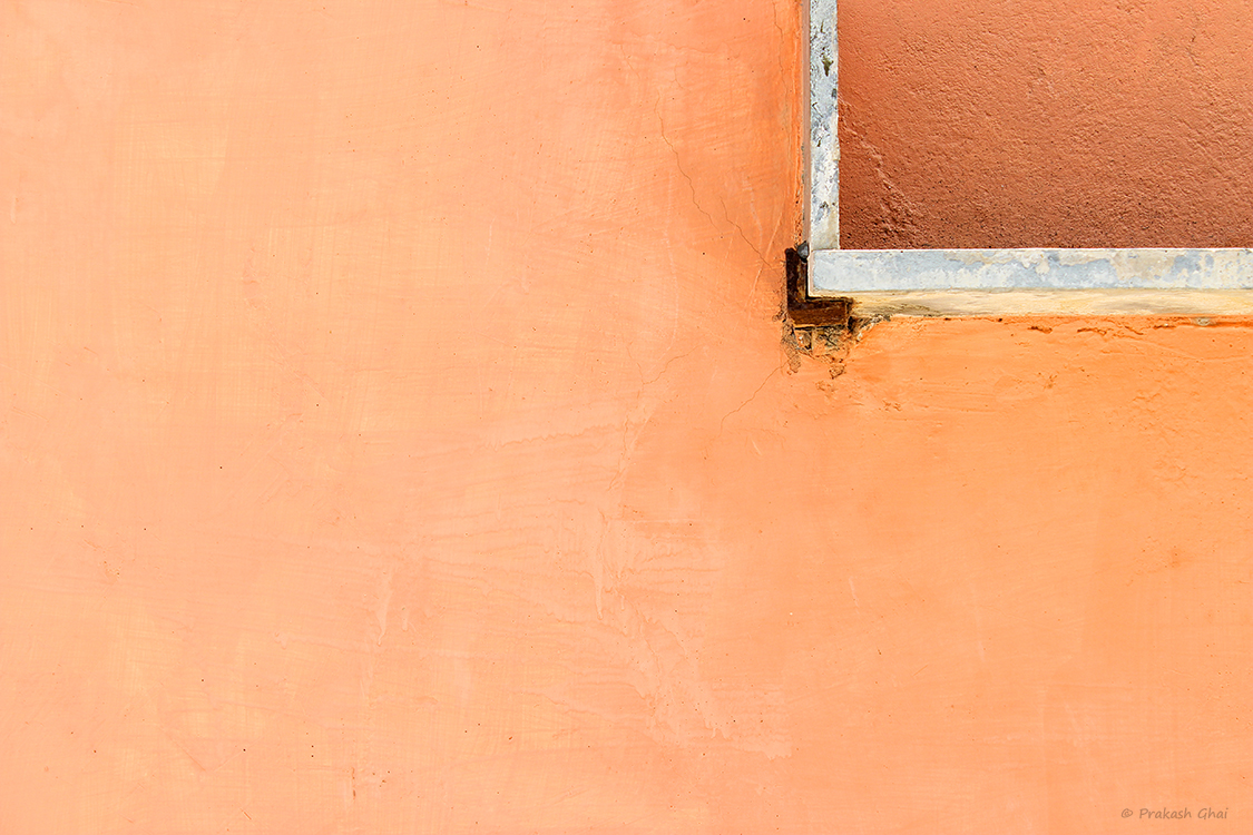 A Minimalist Photo of White marble rectangle on an apricot colored wall