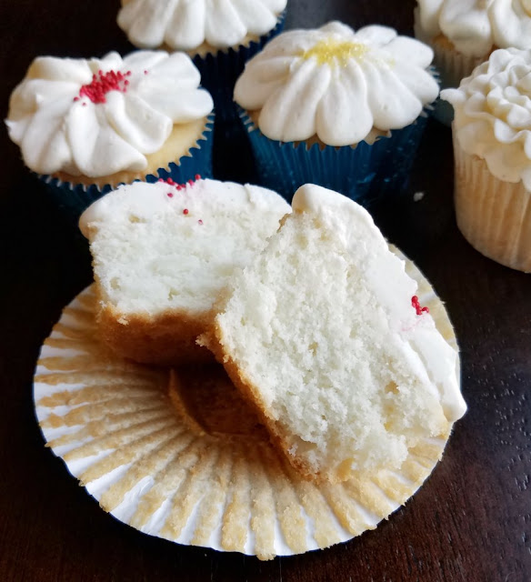 semi-homemade white cupcake cut in half with soft and fluffy interior showing