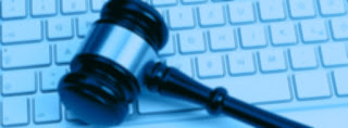 image of gavel lying on a computer keyboard