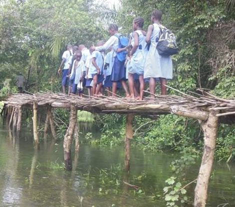 Photos: Heart-breaking moment schoolboy falls off wooden bridge and drowns
