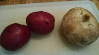 two red potatoes, one turnip (peeled)