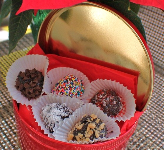 this is a red tin with chocolate covered assorted truffles