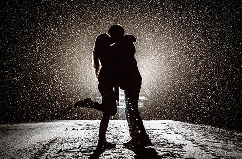 Beautiful Love Couple Kissing in the Snow at Night