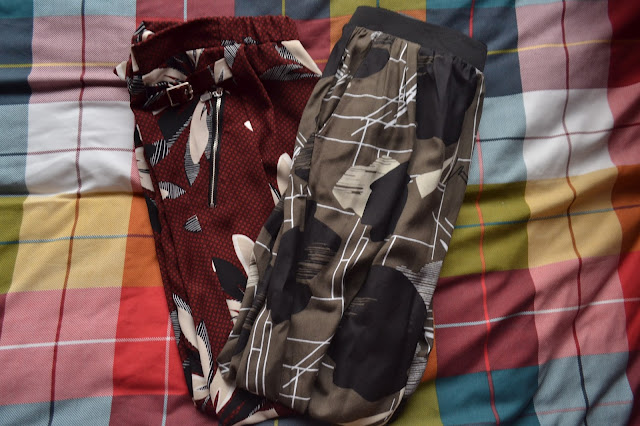 River Island jersey trousers in red floral and khaki pattern
