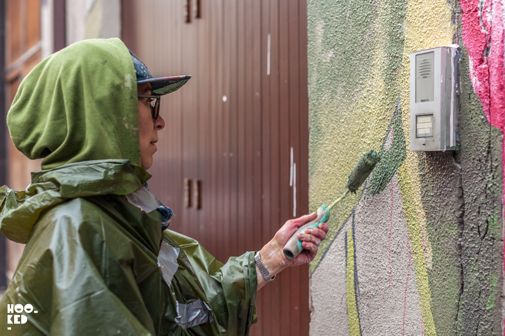 Spanish Street Artist Lula Goce at work on her Waterford Walls in Ireland.