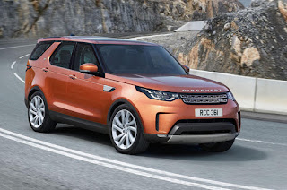 2017 Land Rover Discovery orange picture