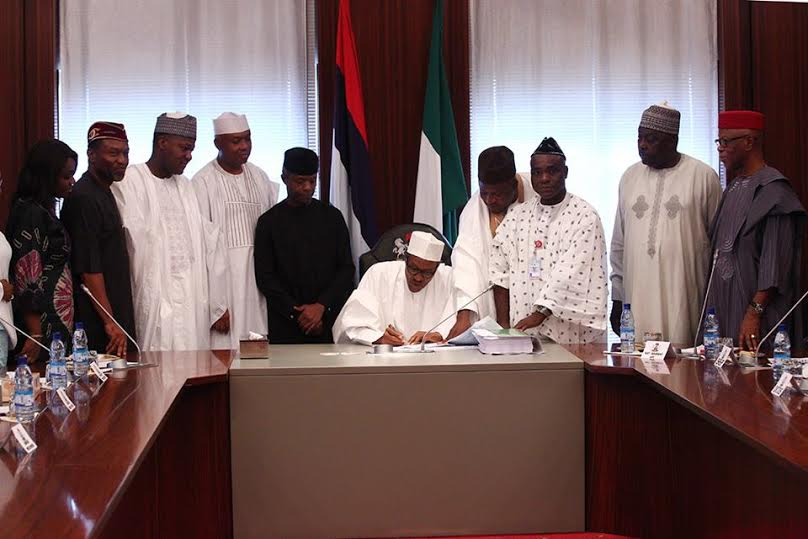 3 Photos: President Buhari signs the 2016 Budget