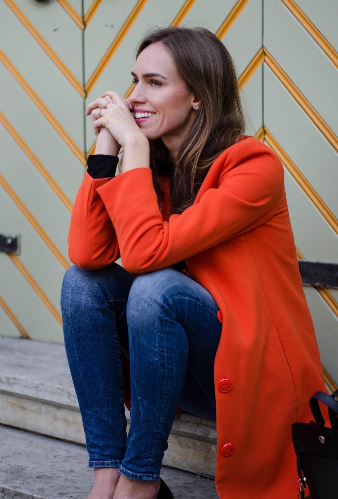 kristjaana mere spring outfit orange coat skinny jeans