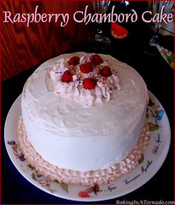 Raspberry Chambord Cake, a beautiful black raspberry infused white cake with cream cheese filling and a whipped cream frosting. | Recipe developed by www.BakingInaTornado.com | #recipe #cake