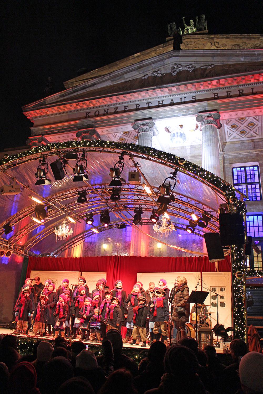 Children's choir singing at the Gendarmenmarkt German Christmas market in Berlin - travel & lifestyle blog