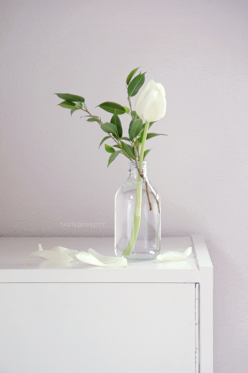 simple scandinavian spring decoration with white tulips in January