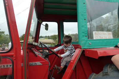 Child sitting in a tractor