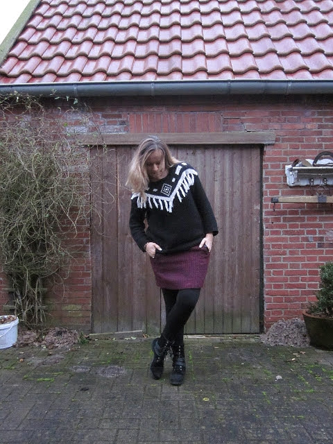 Two times: Skirt with lace-up-boots