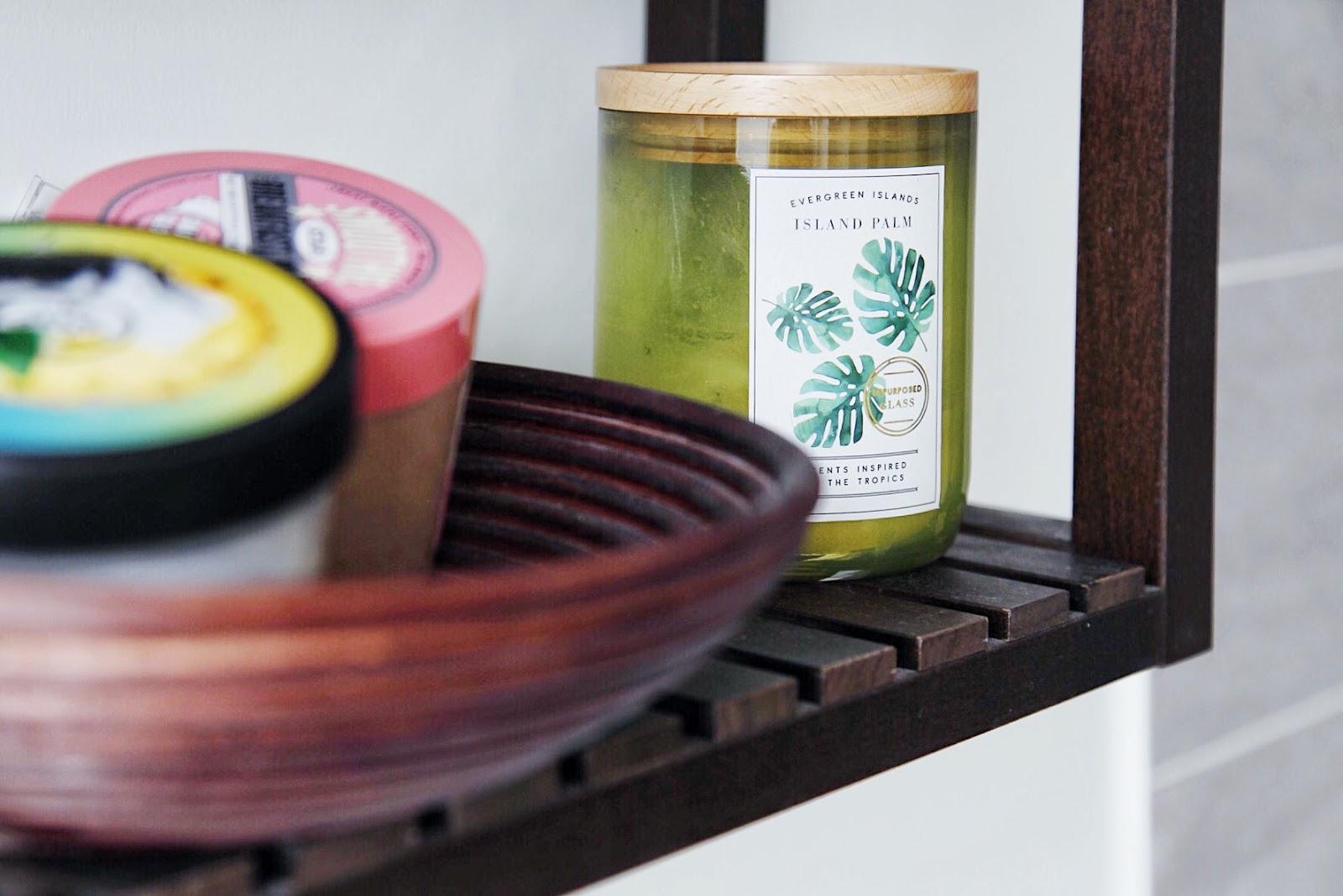 Close up of DW Home Island Tropics candle on IKEA Molger shelves.