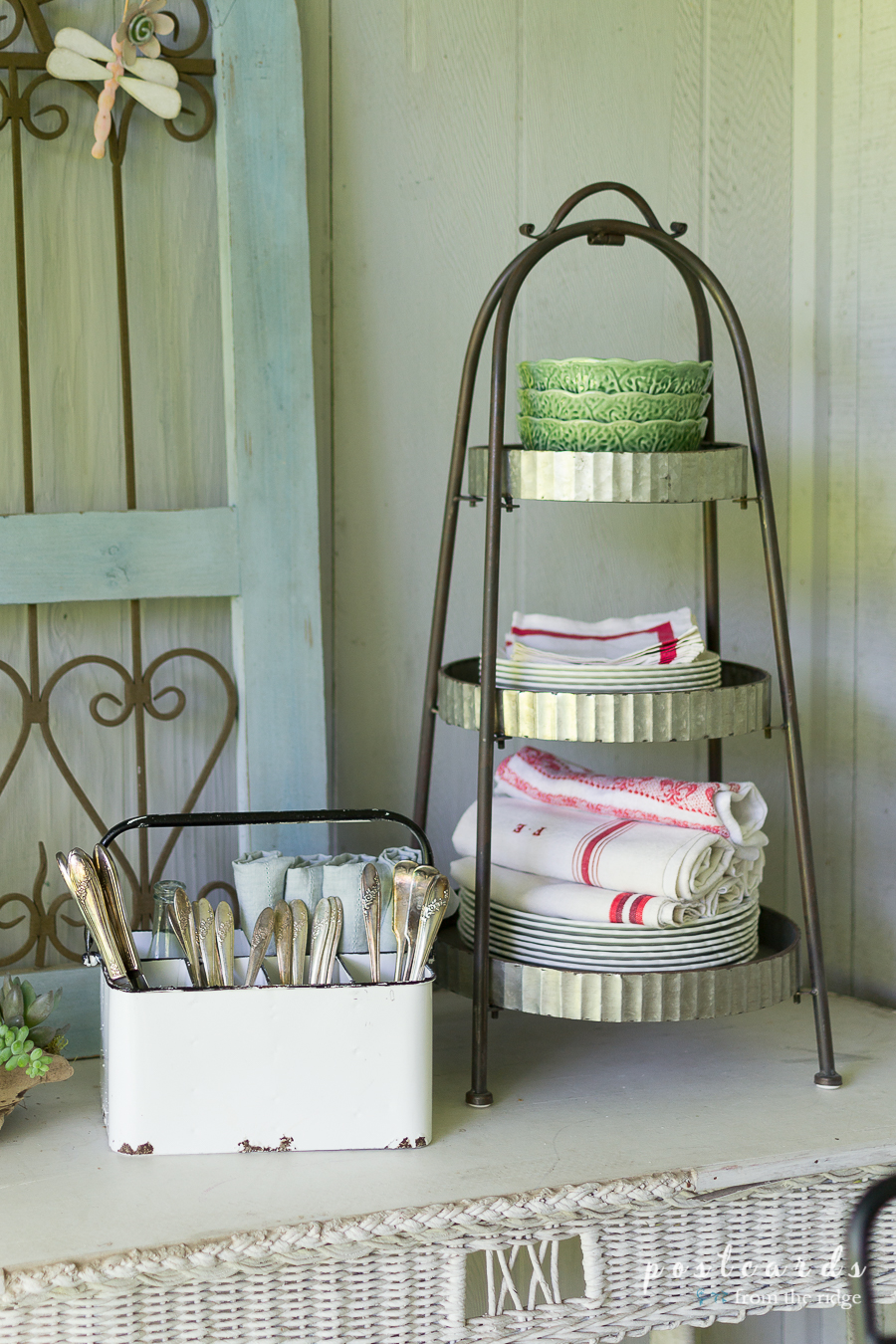 white enamelware utensil caddy and galvanized tiered stand