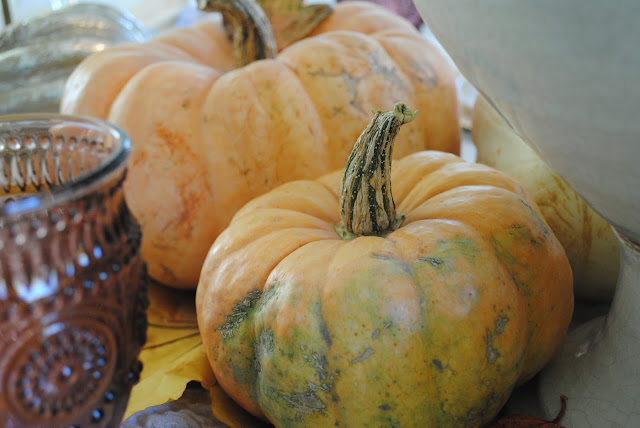 Fall centerpice peach colored pumpkins