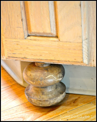 Repurposed bed spindles become bun feet in the kitchen.