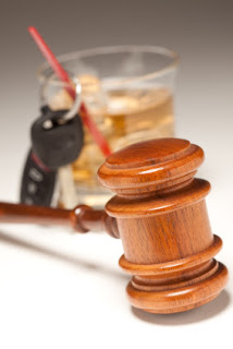 A gavel, keys, and alcoholic beverage