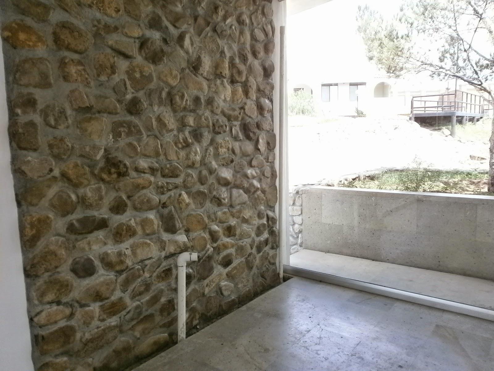 Como cubrir un muro de concreto con piedras y mortero - Muro de piedra natural ...