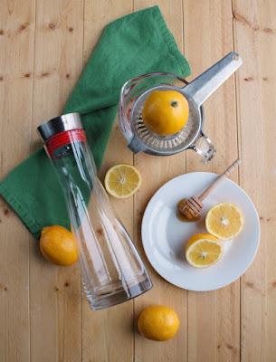 pitcher lying next to honey lemonade ingredients
