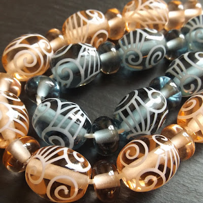 Lampwork glass beads decorated with stringer, by Laura Sparling