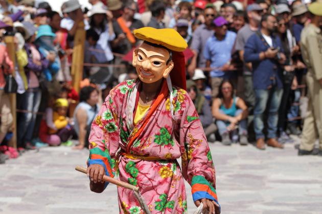 Smiling masked dance performer at Hemis Monastery Festival, Ladakh