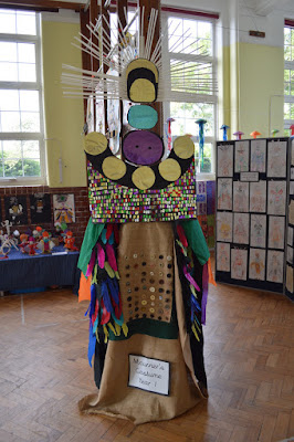 Replica Mourner's Costume stands in the middle of a school hall