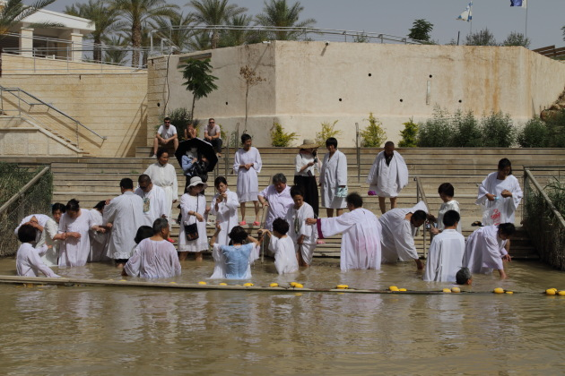 Pilgrims getting baptized at Bethany on the Israel side of the Jordan river