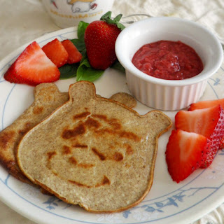 Winnie the pooh pancakes with strawberry sauce