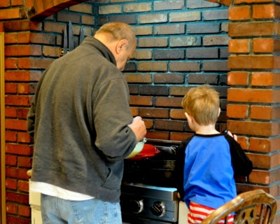Grandfather and grandson making bear pancakes. Just one more reason to Make Tonight #PancakeNight.