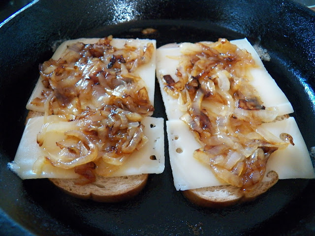 Caramelized Onions on Swiss Cheese on Rye Bread