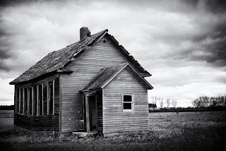 Black and white image of an abandoned school house in rural Norht Dakota near the town of Rugby.