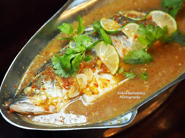 Pla Neung Manao ~ Steamed Seabass with fragrant lime broth.