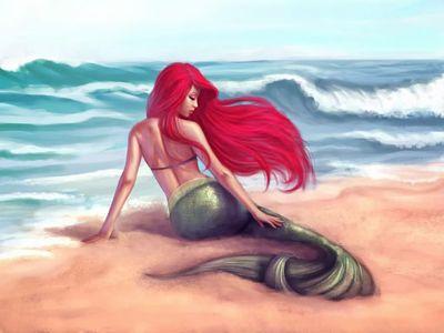 Sirena descansando en la orilla del mar