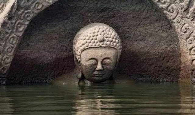 Ancient Buddha statue emerges in east China reservoir