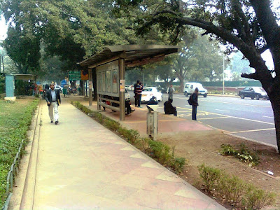 Photo of a Bus Stand from the NDMC area in New Delhi. Photo clicked by Sandeep Vij at http://www.google.com/+SandeepVijArchitectsNewDelhi . This is not Sandeep Vij's Design exactly, but glimpses of his Design Submission from 2001 (!) can be seen. In 2001, an Architectural Design Competition was held by New Delhi Municipal Council for Bus Q Shelter Designs. Architect, Picture, Urban Shot, Year 2015, City Life.