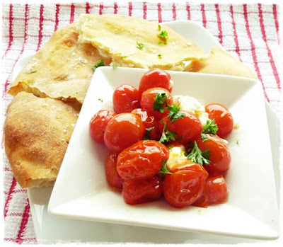 boursin cream cheese with hot roasted tomatoes and potato flatbread