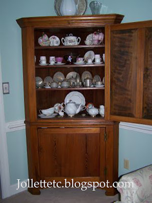 Teacup collection in corner cabinet  https://jollettetc.blogspot.com