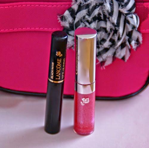 Lancome black mascara and pink sparkly lip gloss
