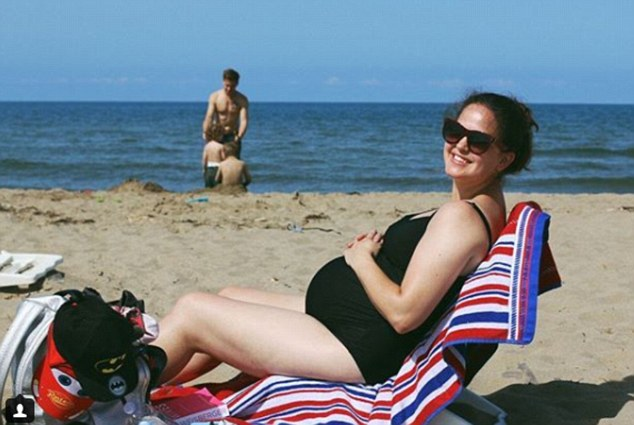 Giovanna Fletcher displays her baby bump in a black swimsuit during family trip to Italy