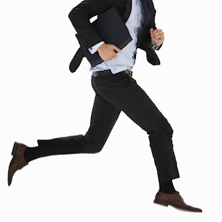 image of a business man running.