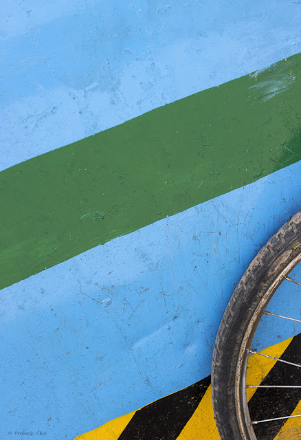 A Minimalist Photo of Bicycle Tyre and Colorful Lines
