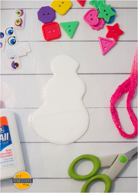 use google eyes, buttons, pipe cleanres and any other materials you have to make the features of the snowman on the wet glue