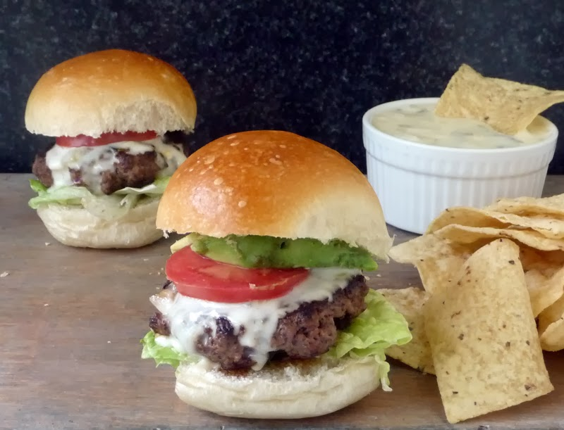 Taco Sliders - These little burgers made with taco seasoning are a nice change of pace. It takes 2 of my favorites, tacos and burgers, and mashes them together into one tasty little treat! Adding Queso Blanco takes them over-the-top!! So yummy!